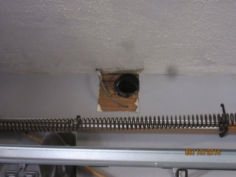 Kitchen vent discharges into garage